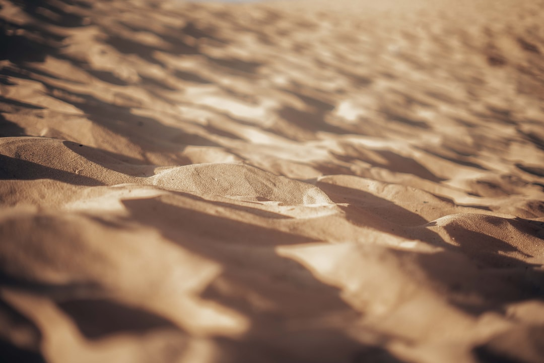 Brown Sand With Water During Daytime - unsplash