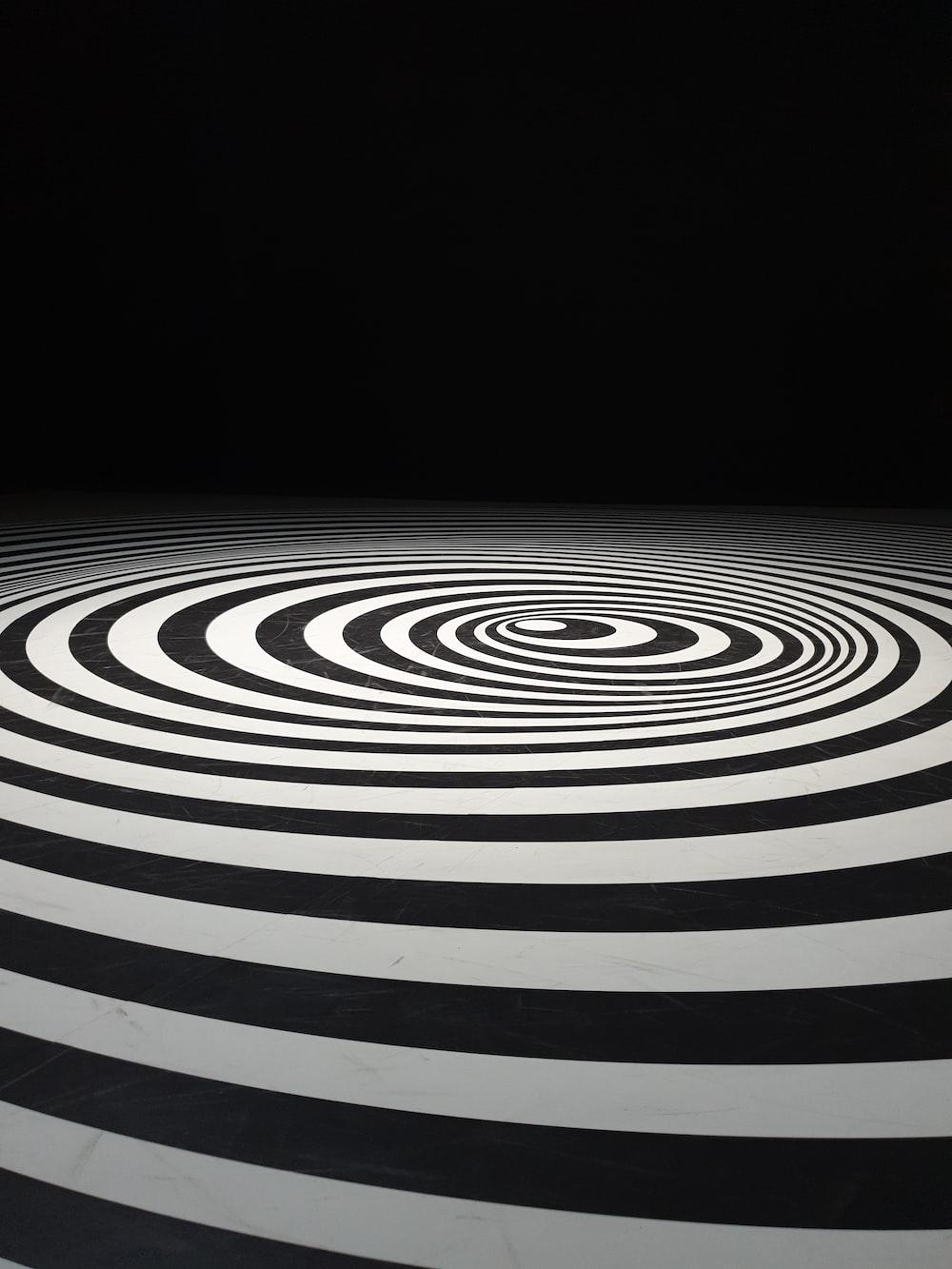 black and white striped round logo