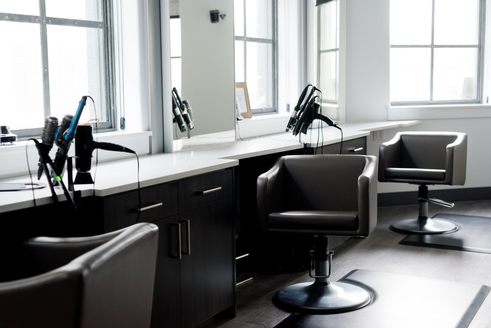black and silver barber chair