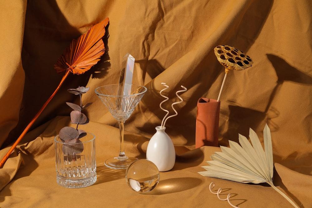 clear glass vase beside white ceramic vase
