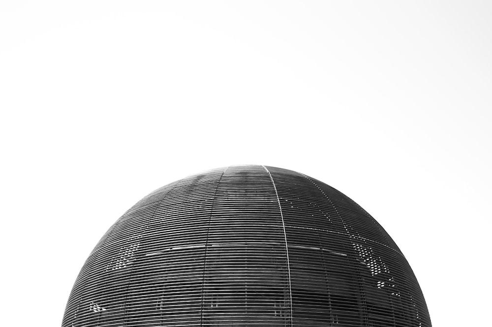 white round ball with black background