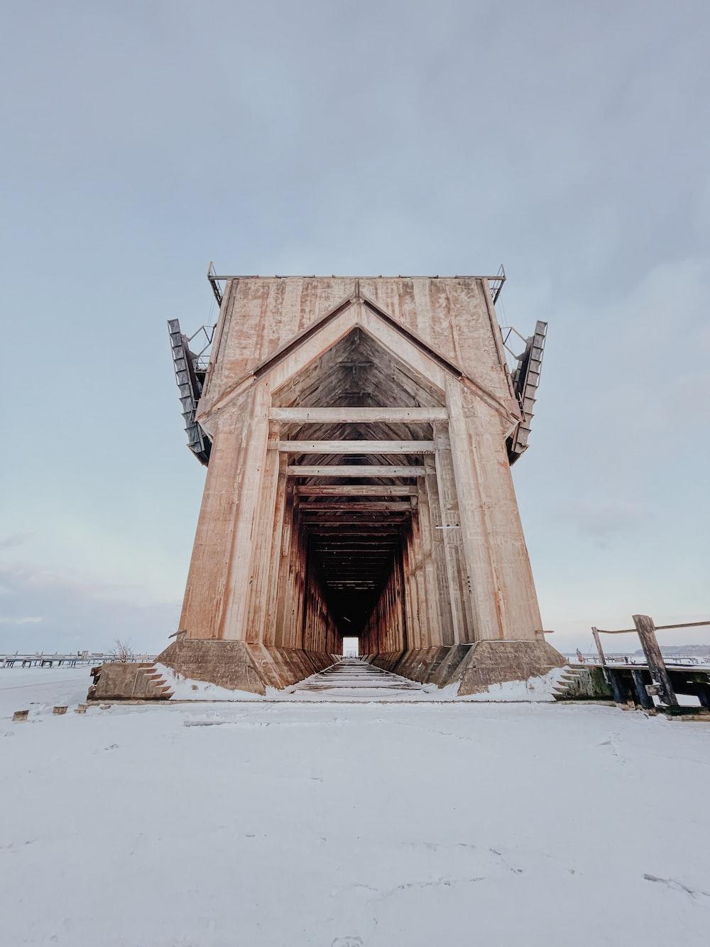 brown wooden bridge under white sky during daytime