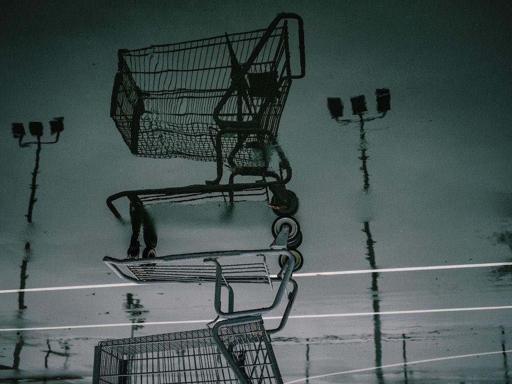 black shopping cart on white floor