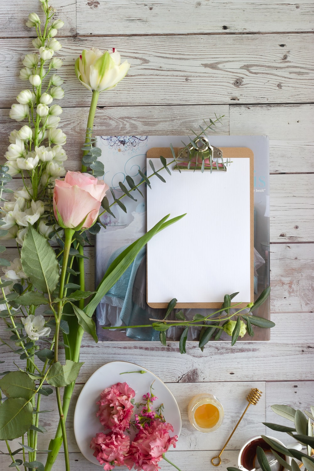 pink tulips on white book