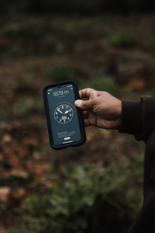 person holding black digital device