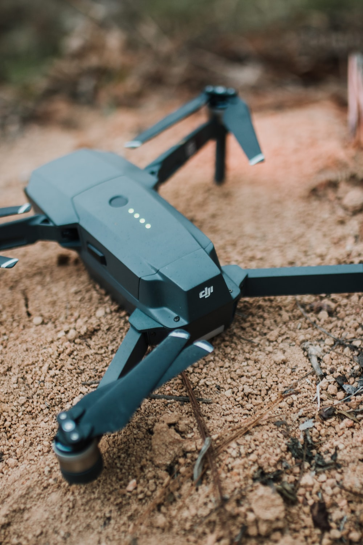 black drone on brown soil