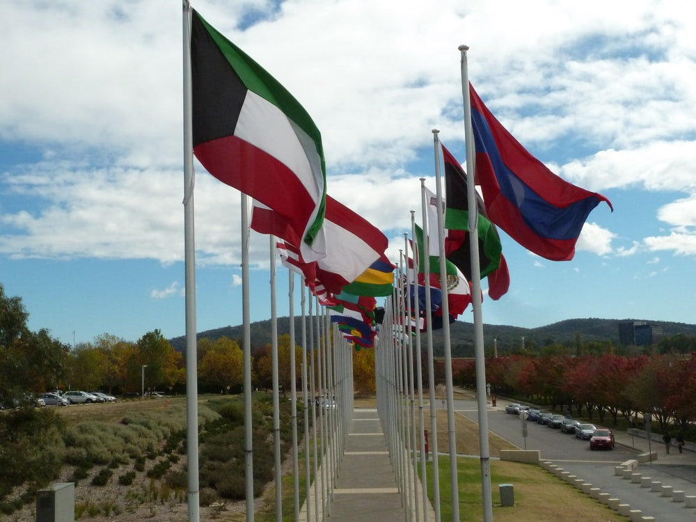 white red and green flags on white metal poles