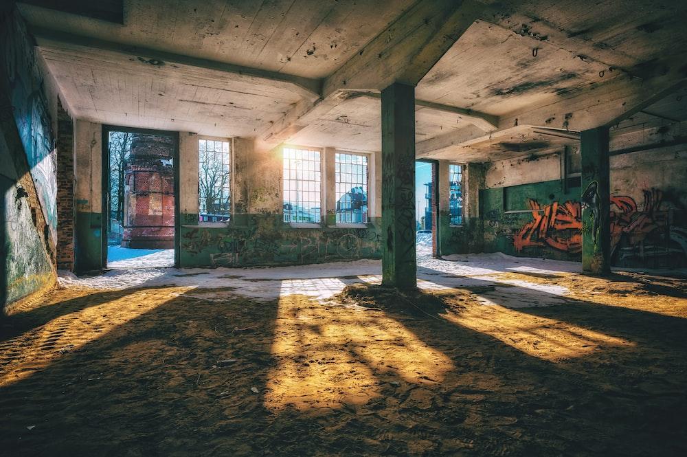 brown wooden bench on brown concrete floor
