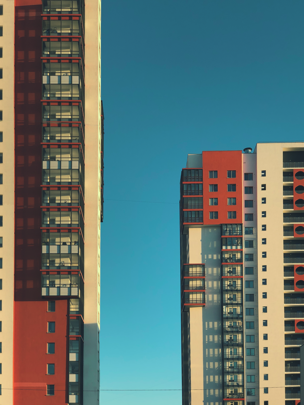 red and white concrete building under blue sky during daytime