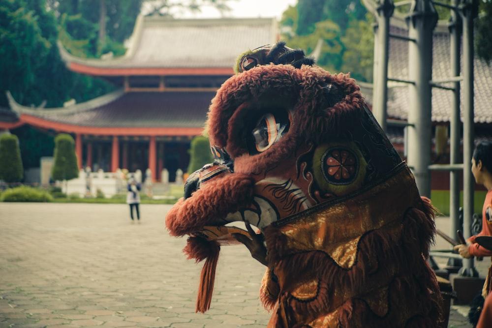 brown and white dragon statue