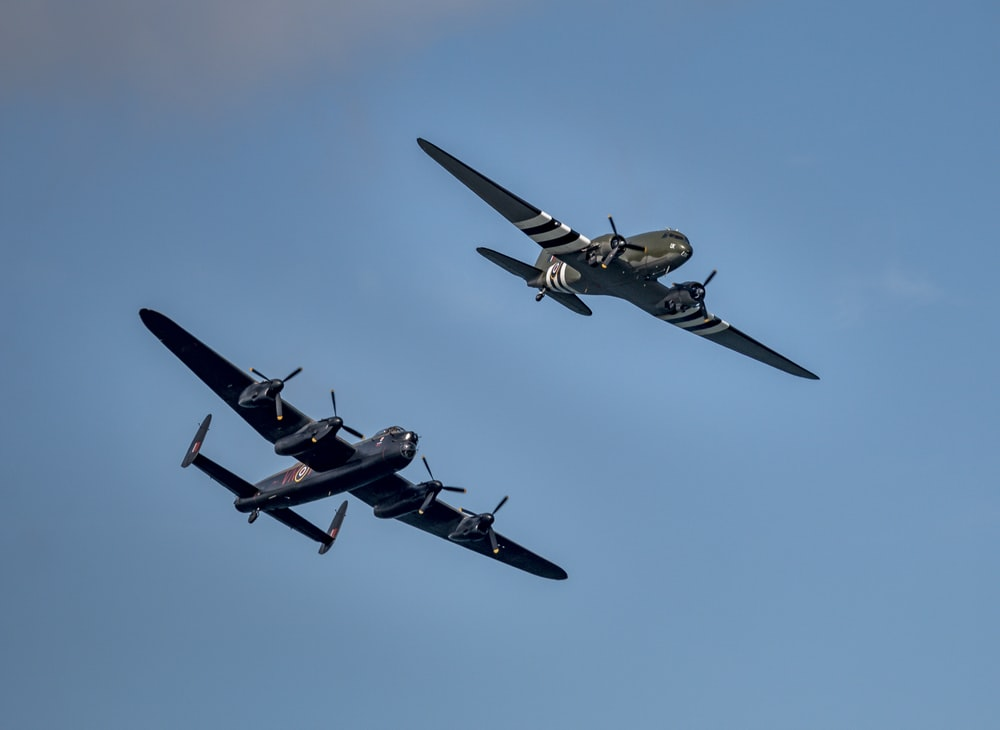 four fighter planes in mid air during daytime