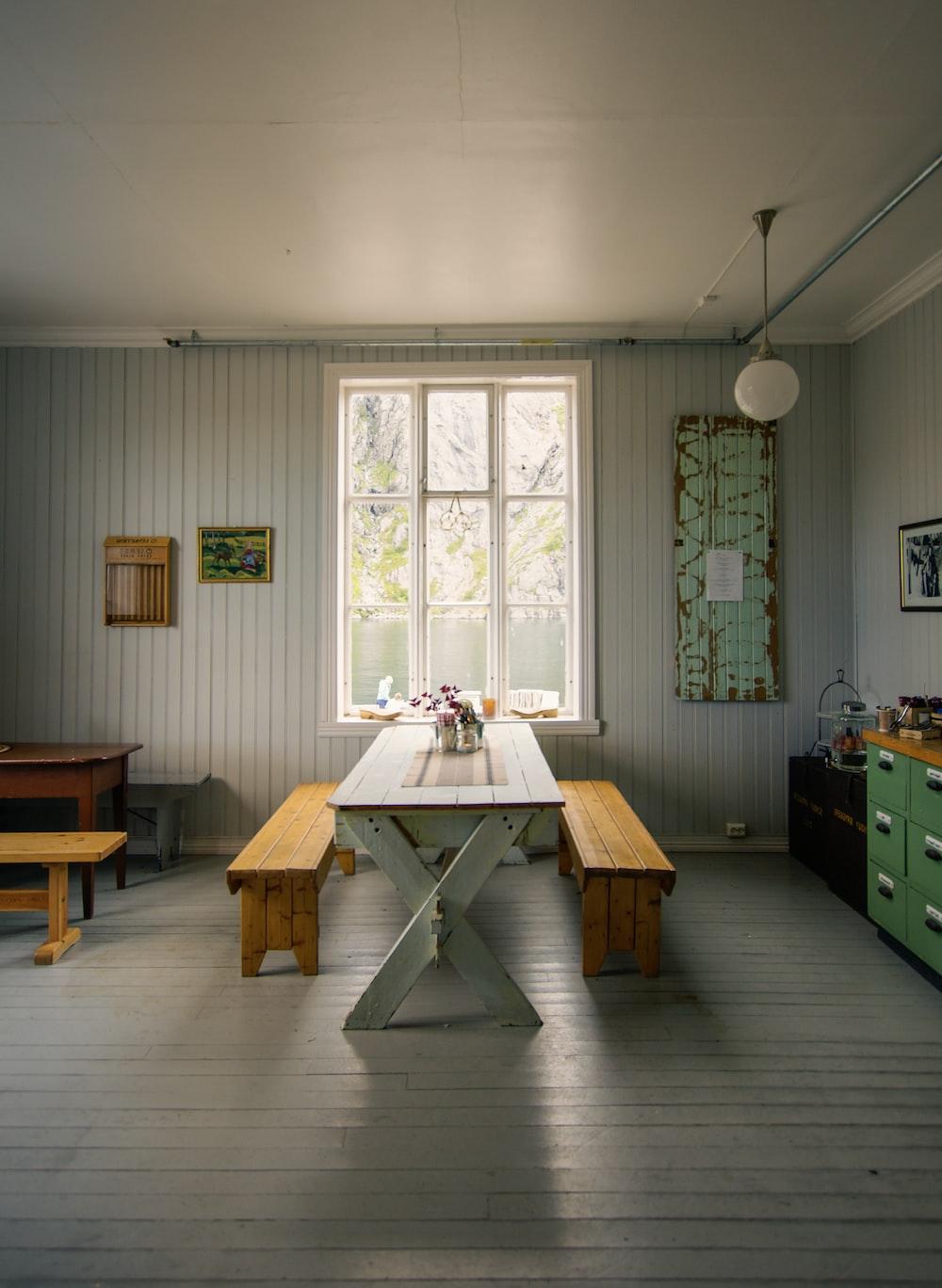brown wooden table near window