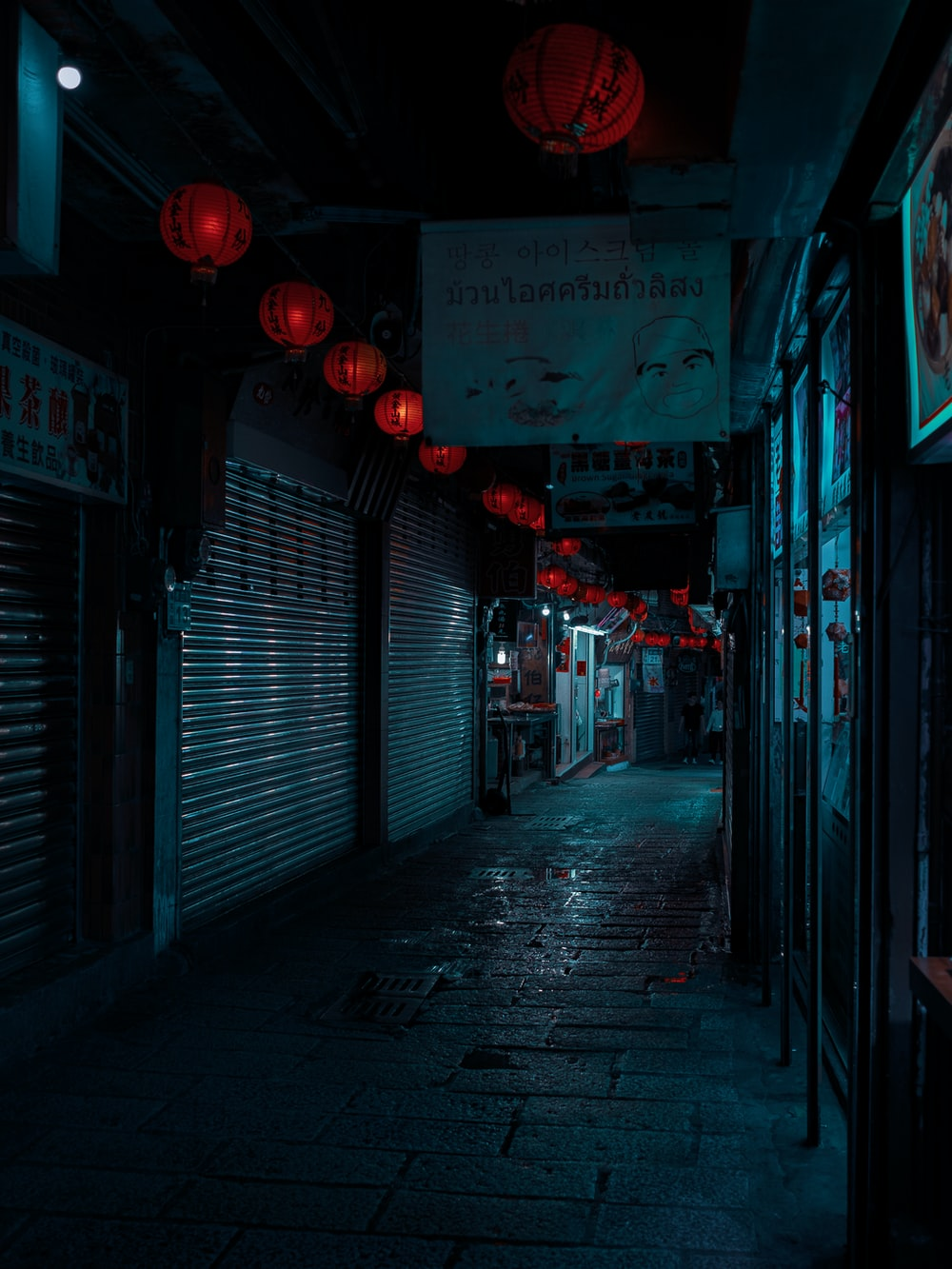 empty street with red light during night time