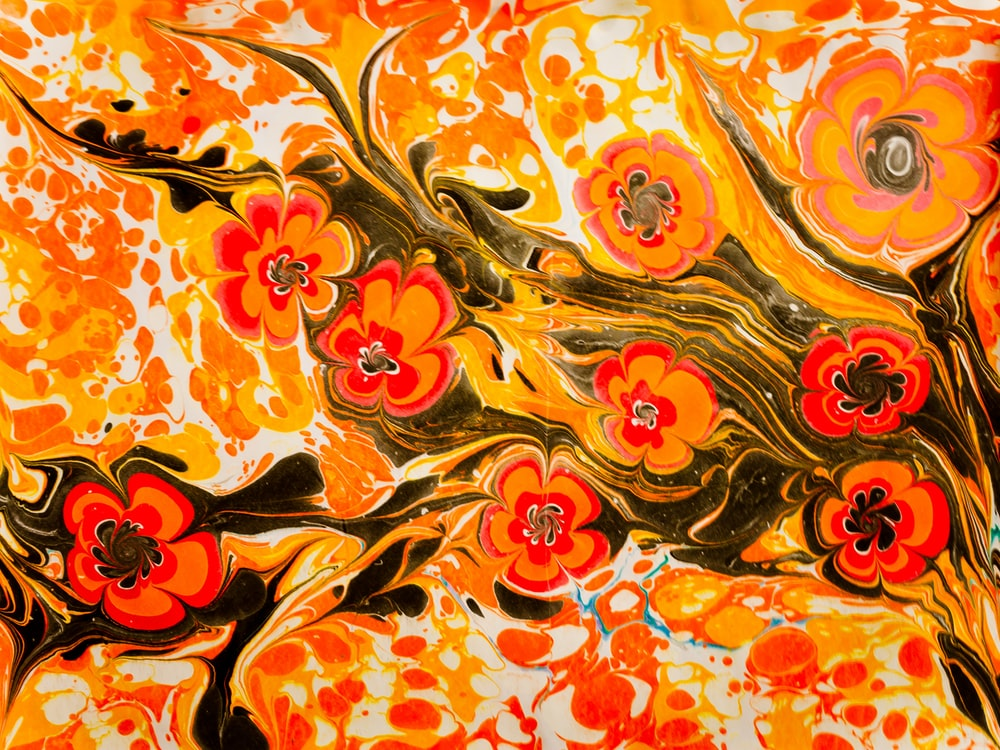 orange and yellow floral textile