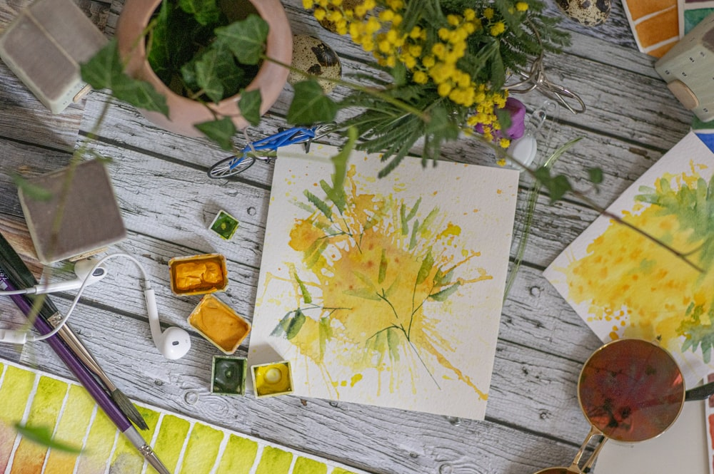 yellow flower on white paper