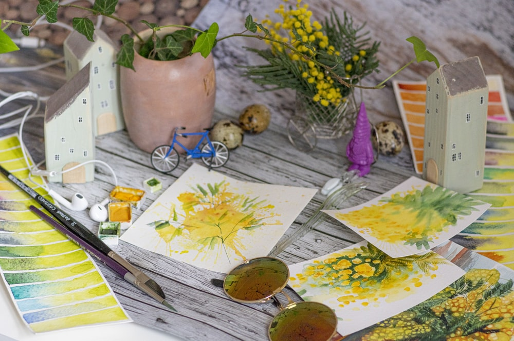 yellow and green flower on white table