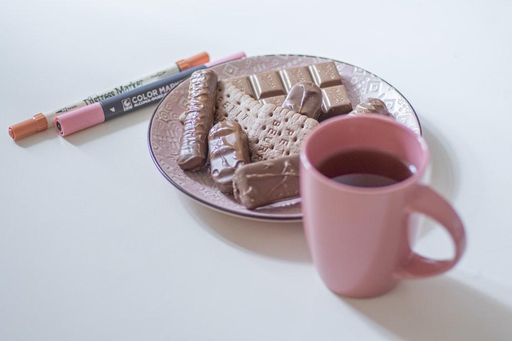 pink ceramic mug on pink saucer