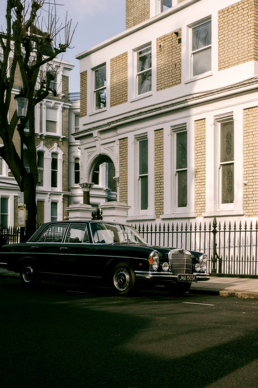 black car parked in front of white building