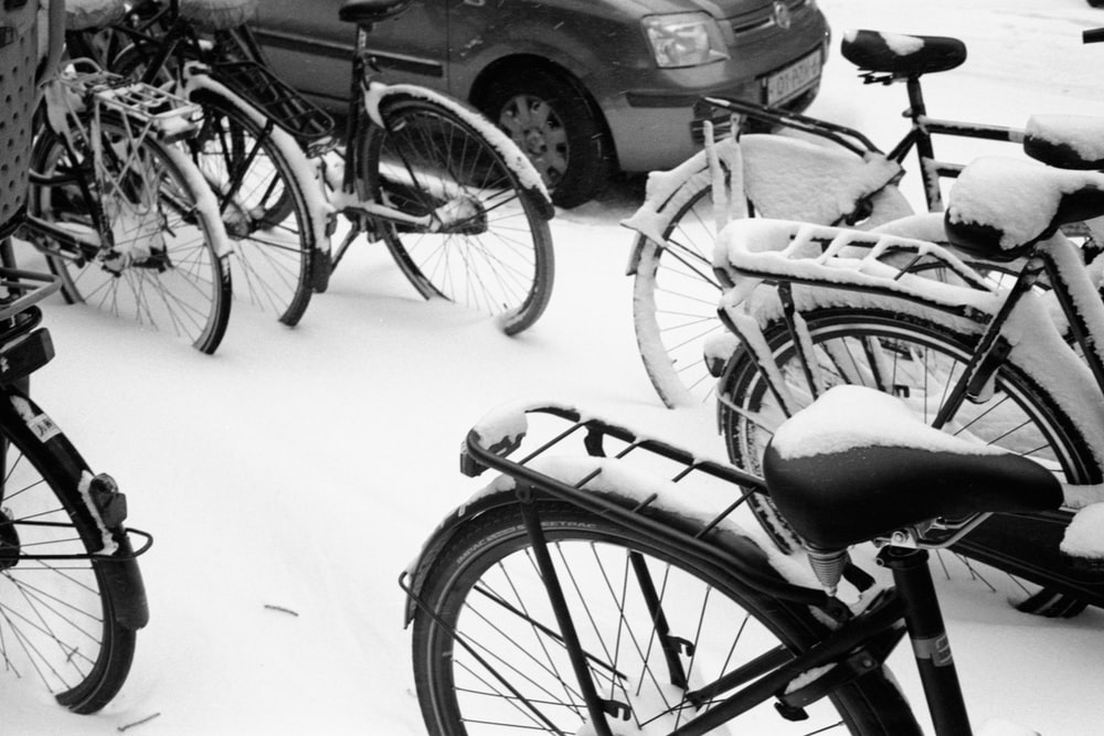 black bicycle on snow covered road