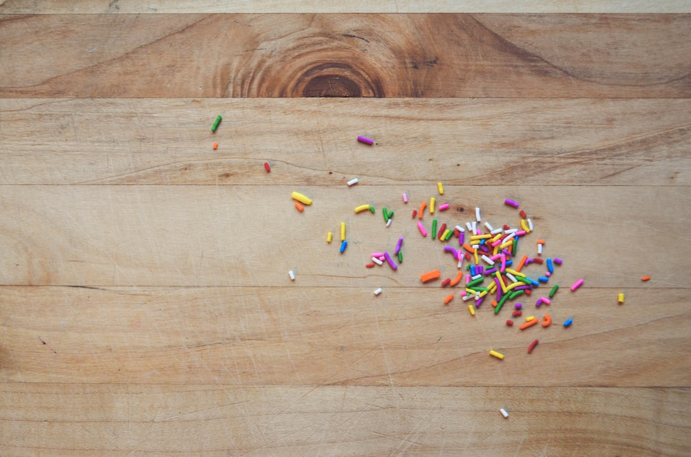multi colored plastic toy on brown wooden table