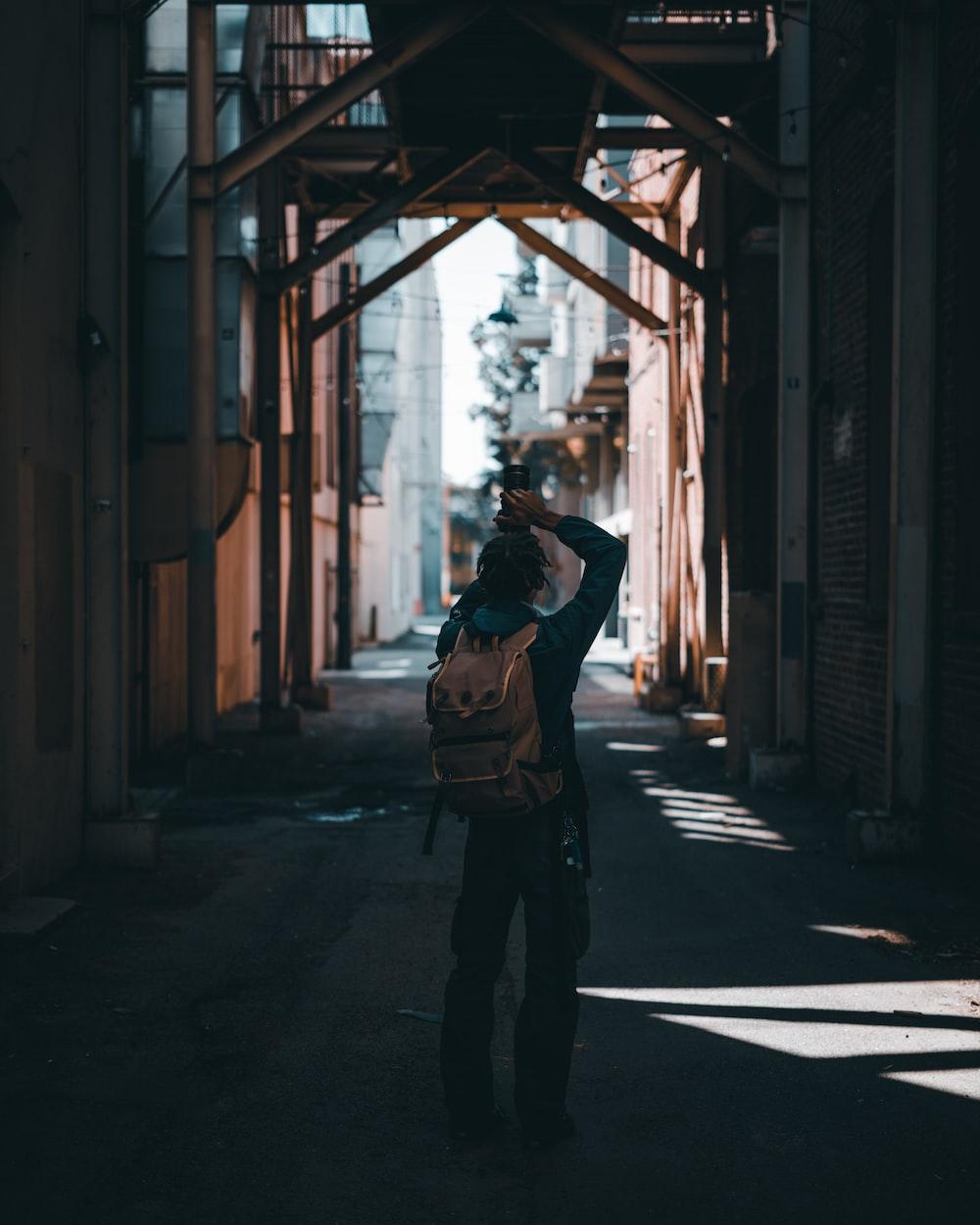 woman in black jacket standing on hallway