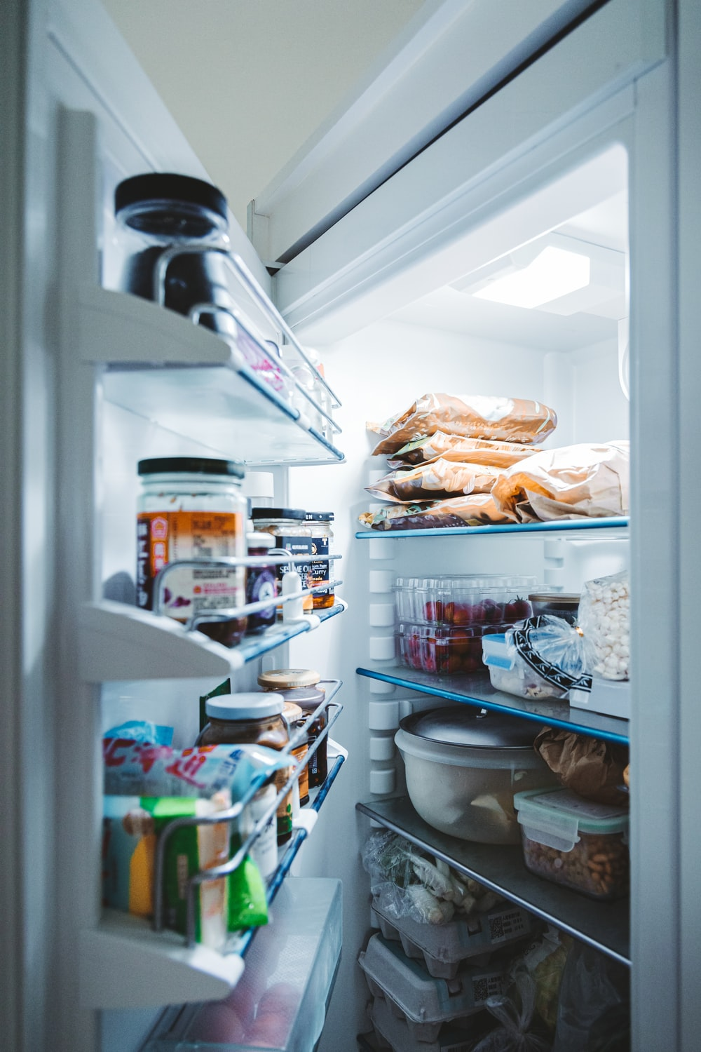 bread in refrigerator with assorted foods