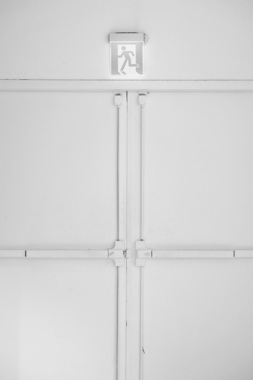 white wooden 2 door cabinet