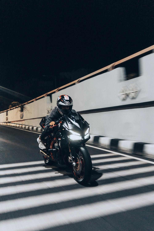 man in black motorcycle helmet riding motorcycle
