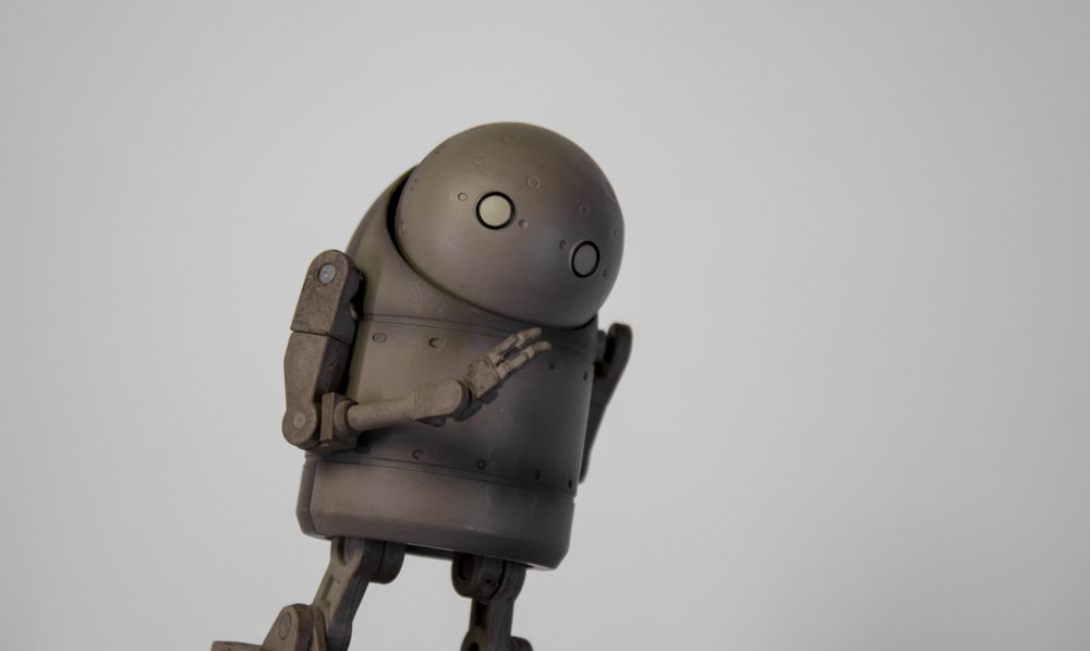 brown robot toy on white background