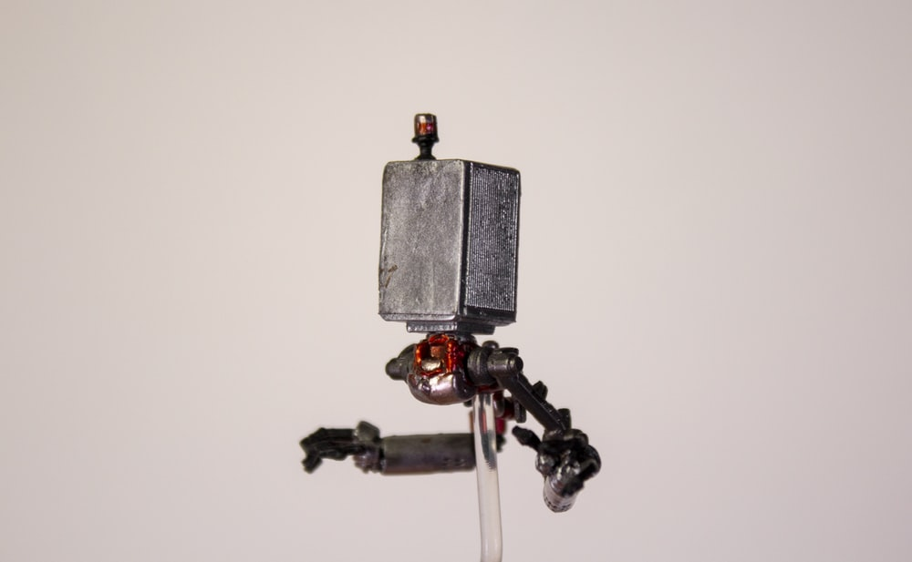 black and gray camera with tripod