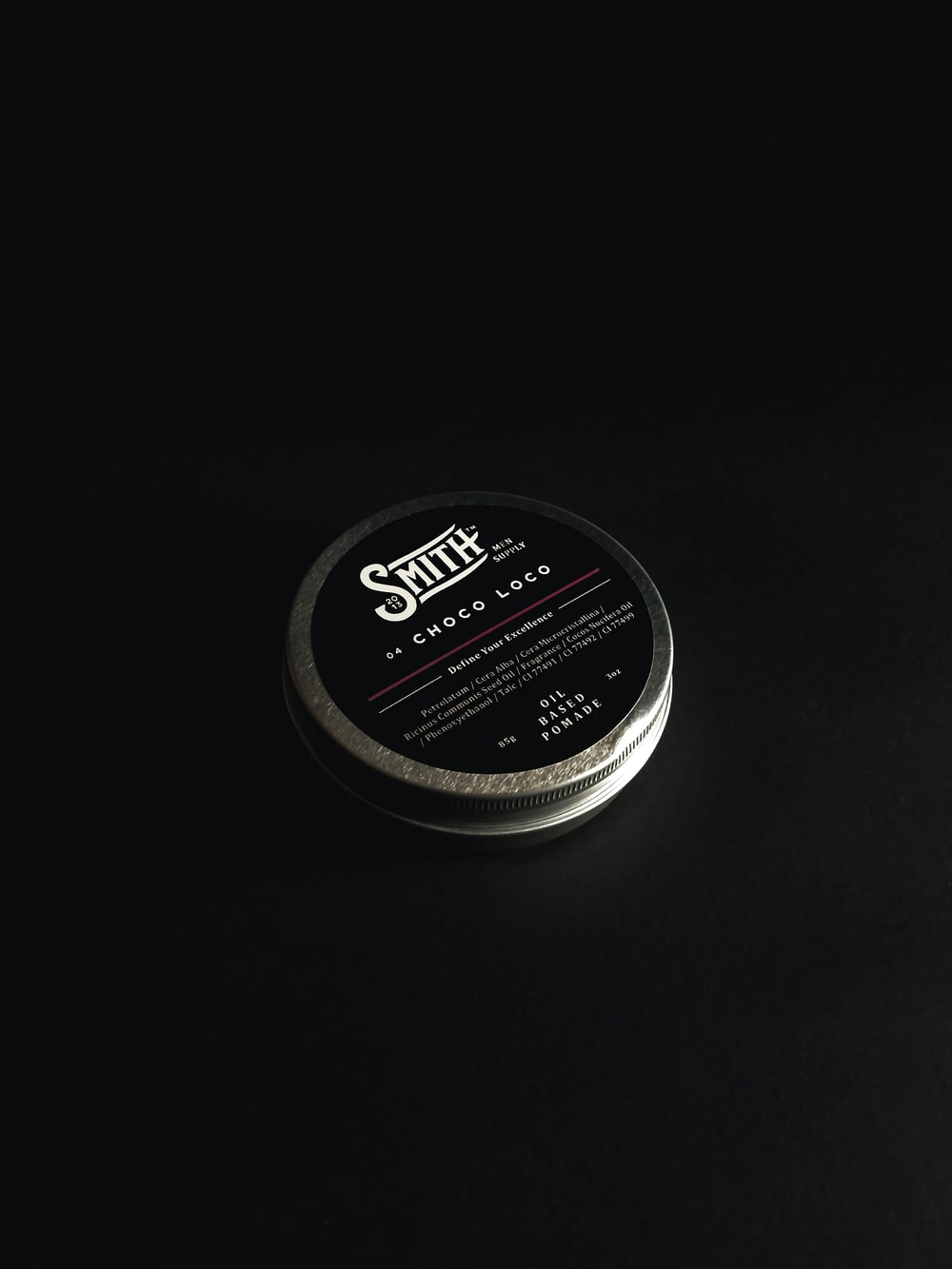 black and silver round container