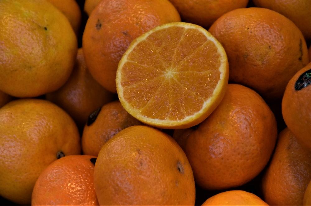 orange fruits on brown wooden shelf