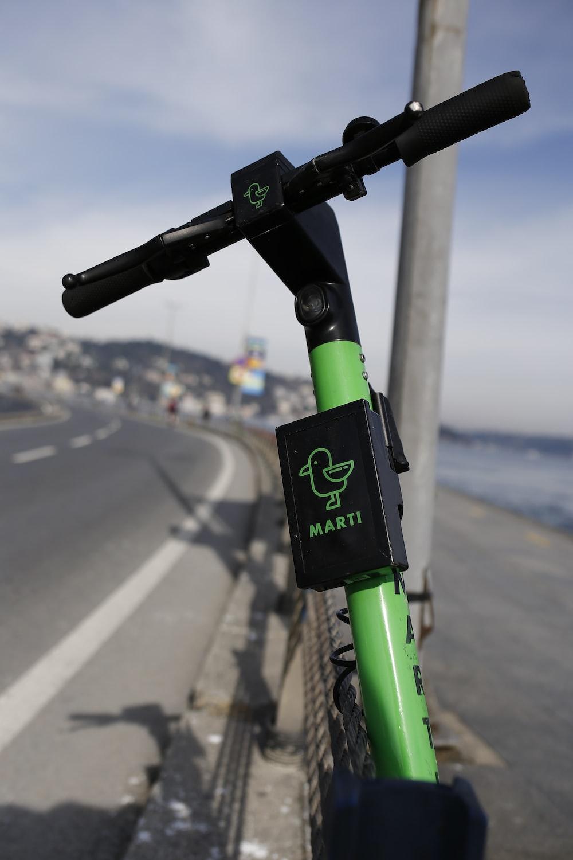 green and black bicycle lane