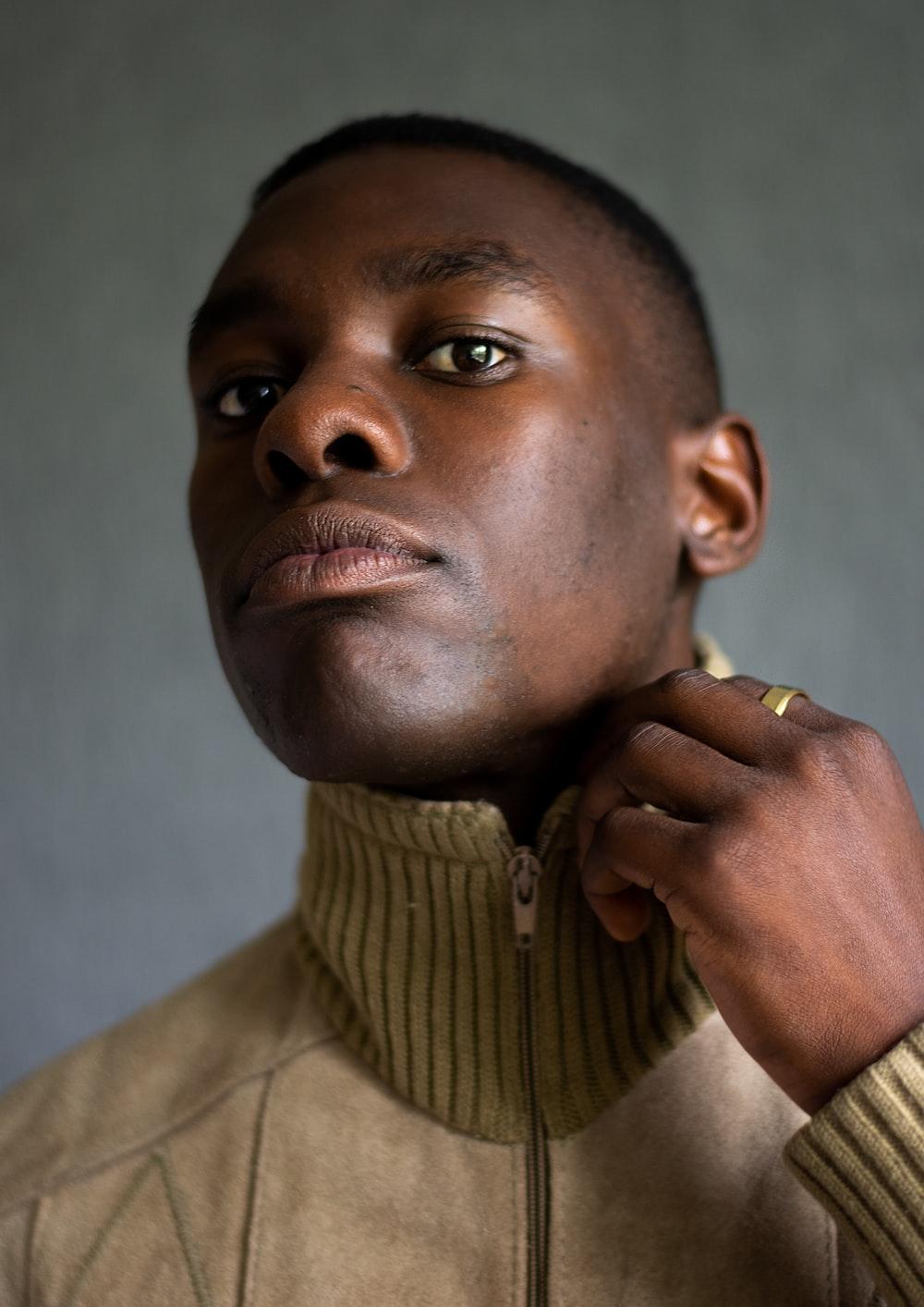 man in brown button up shirt