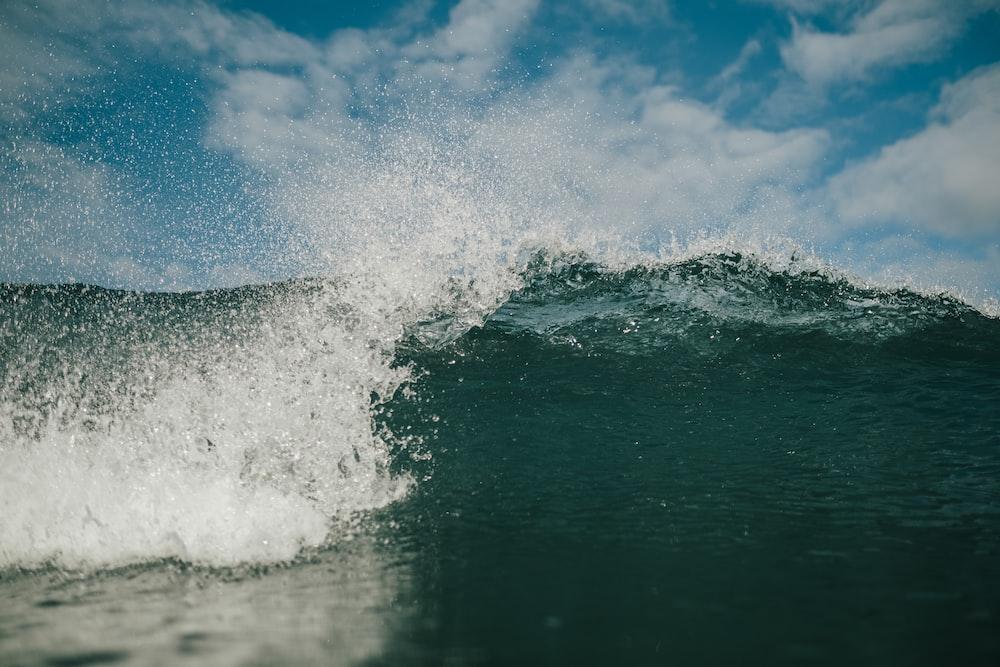 ocean waves under blue sky during daytime