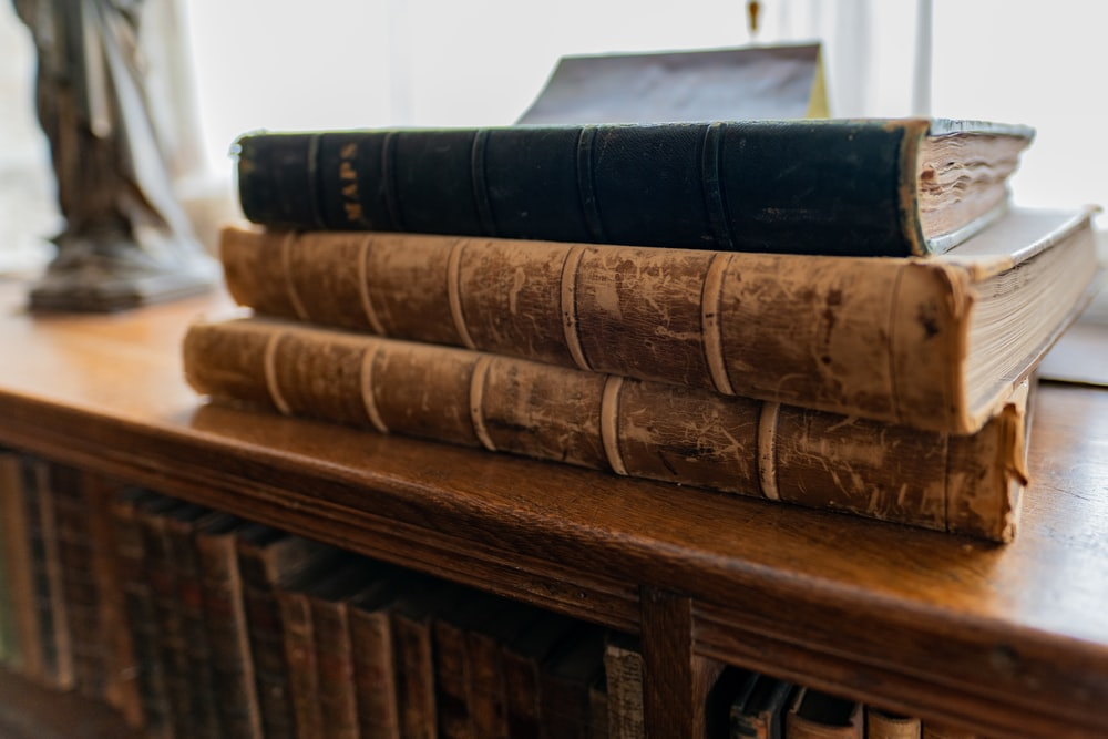 brown and black hardbound books