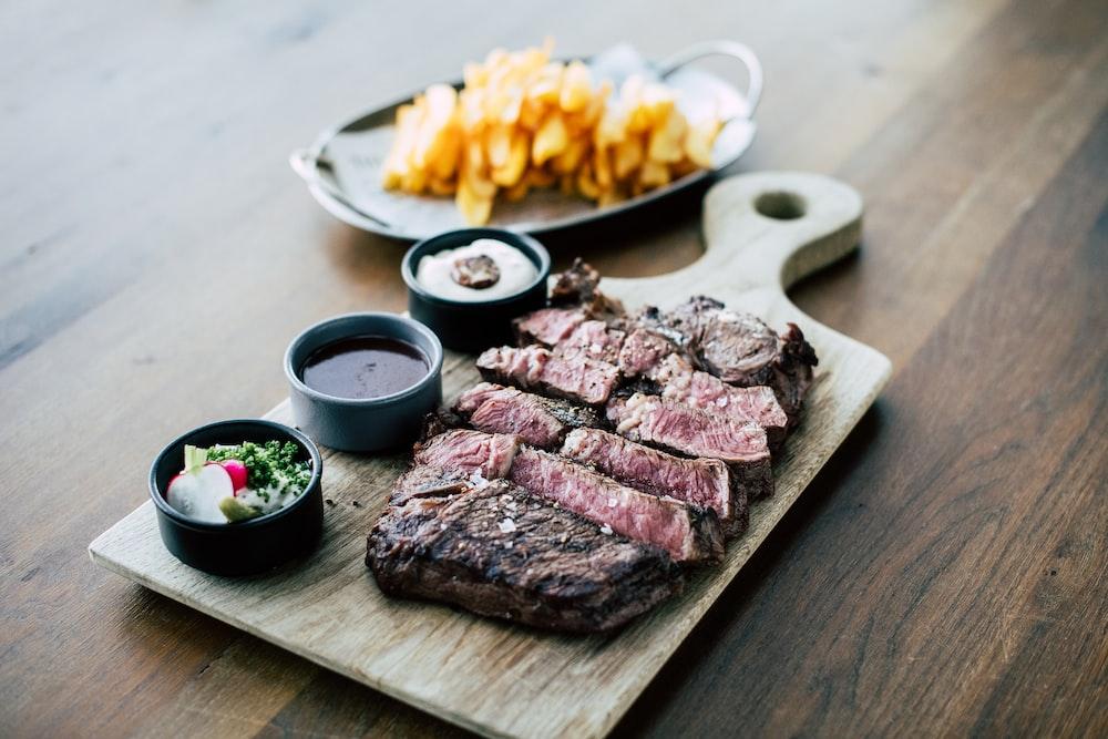 sliced meat on white ceramic plate