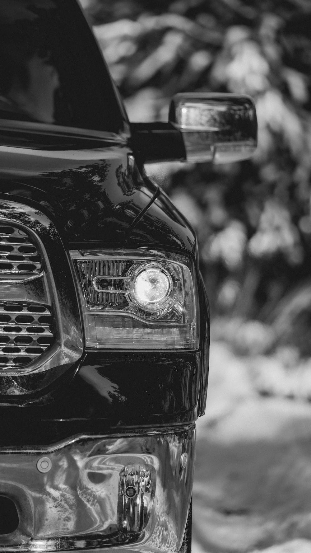 grayscale photo of cars headlight