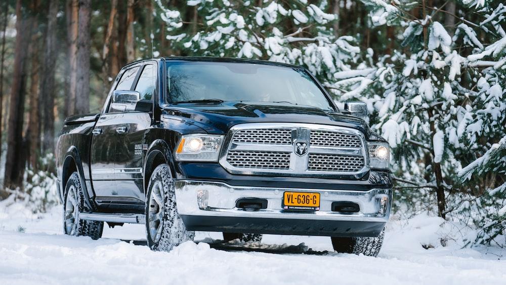 black chevrolet car on snow covered ground