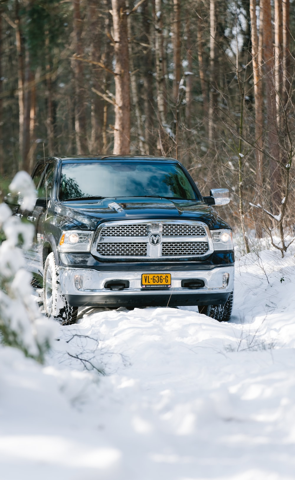 black chevrolet car on snow covered ground during daytime