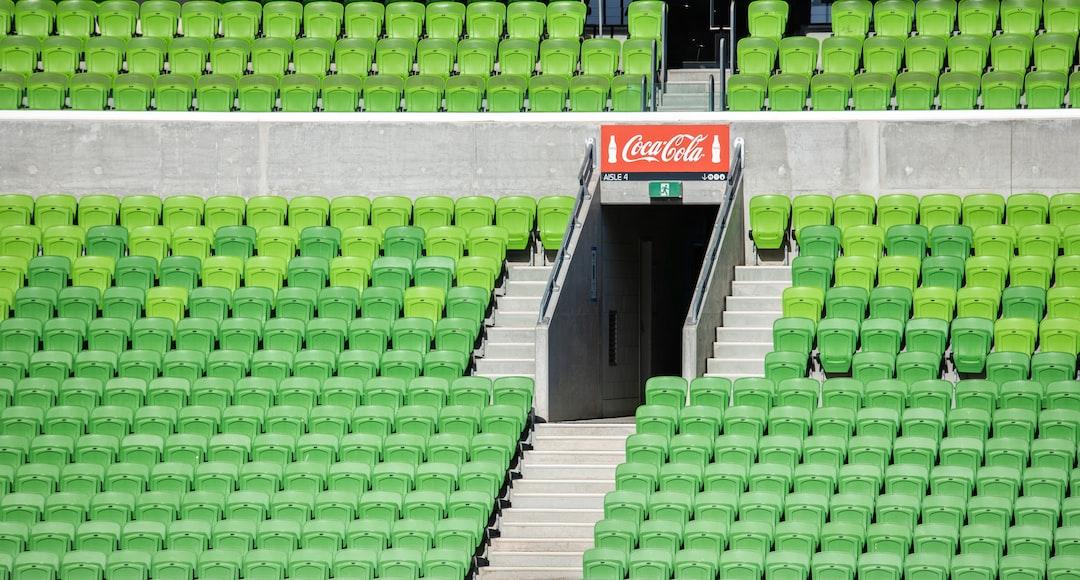 Green and White Stadium Seats - unsplash