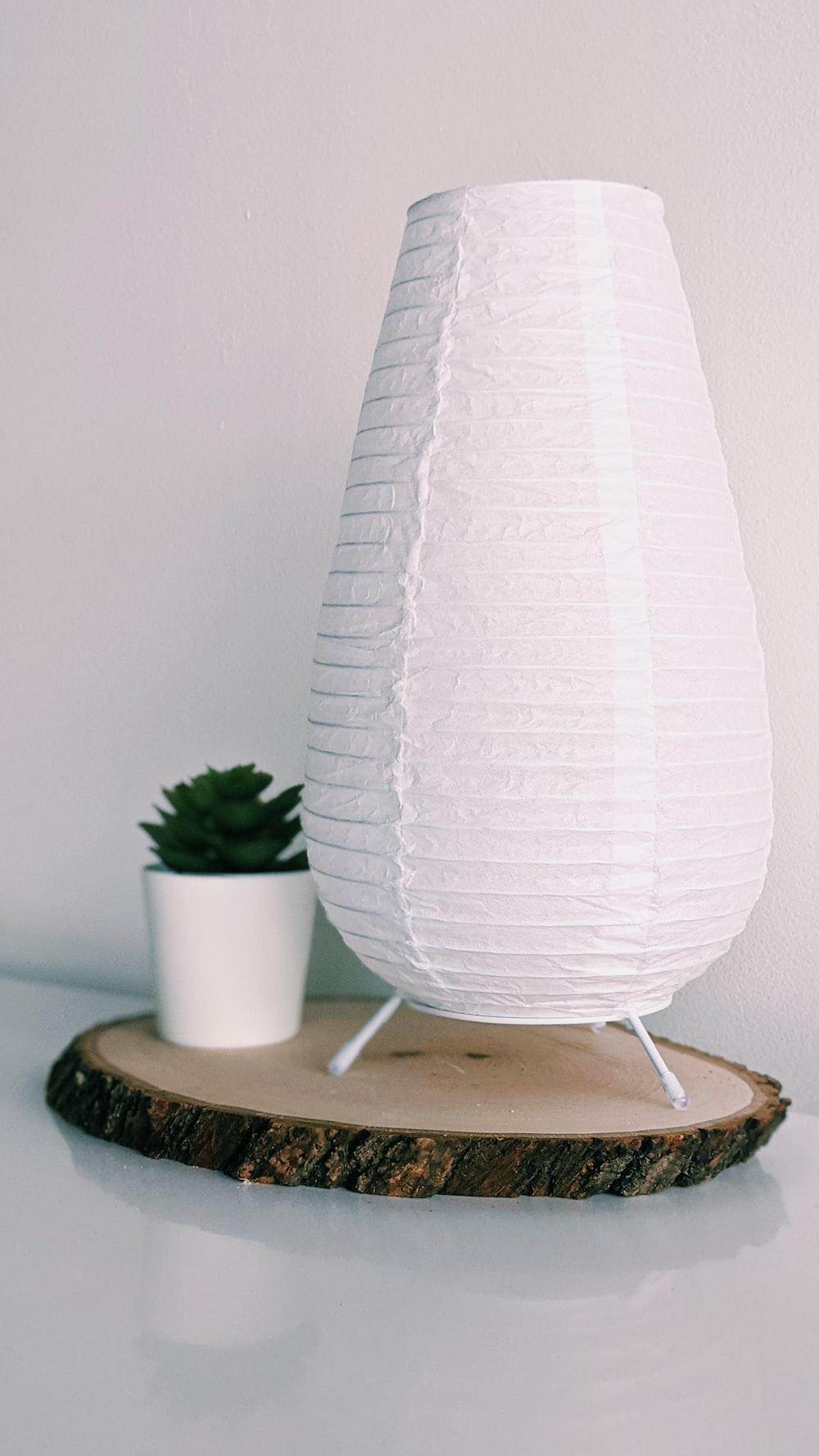 white round lamp on white round table