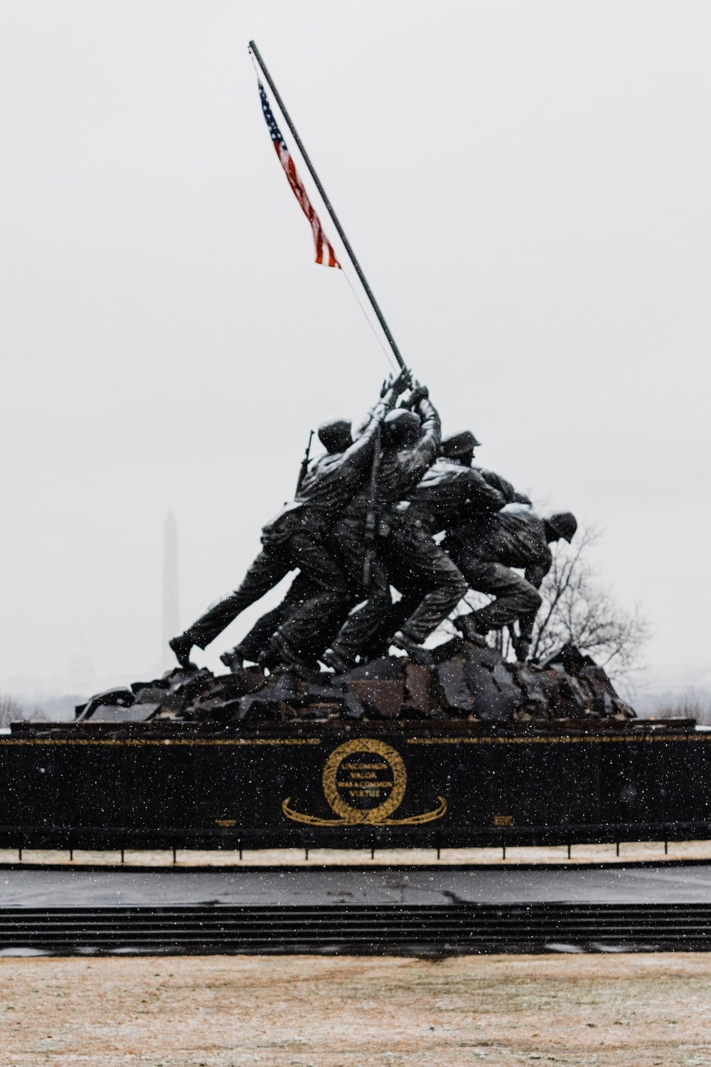 black and red statue of man holding flag