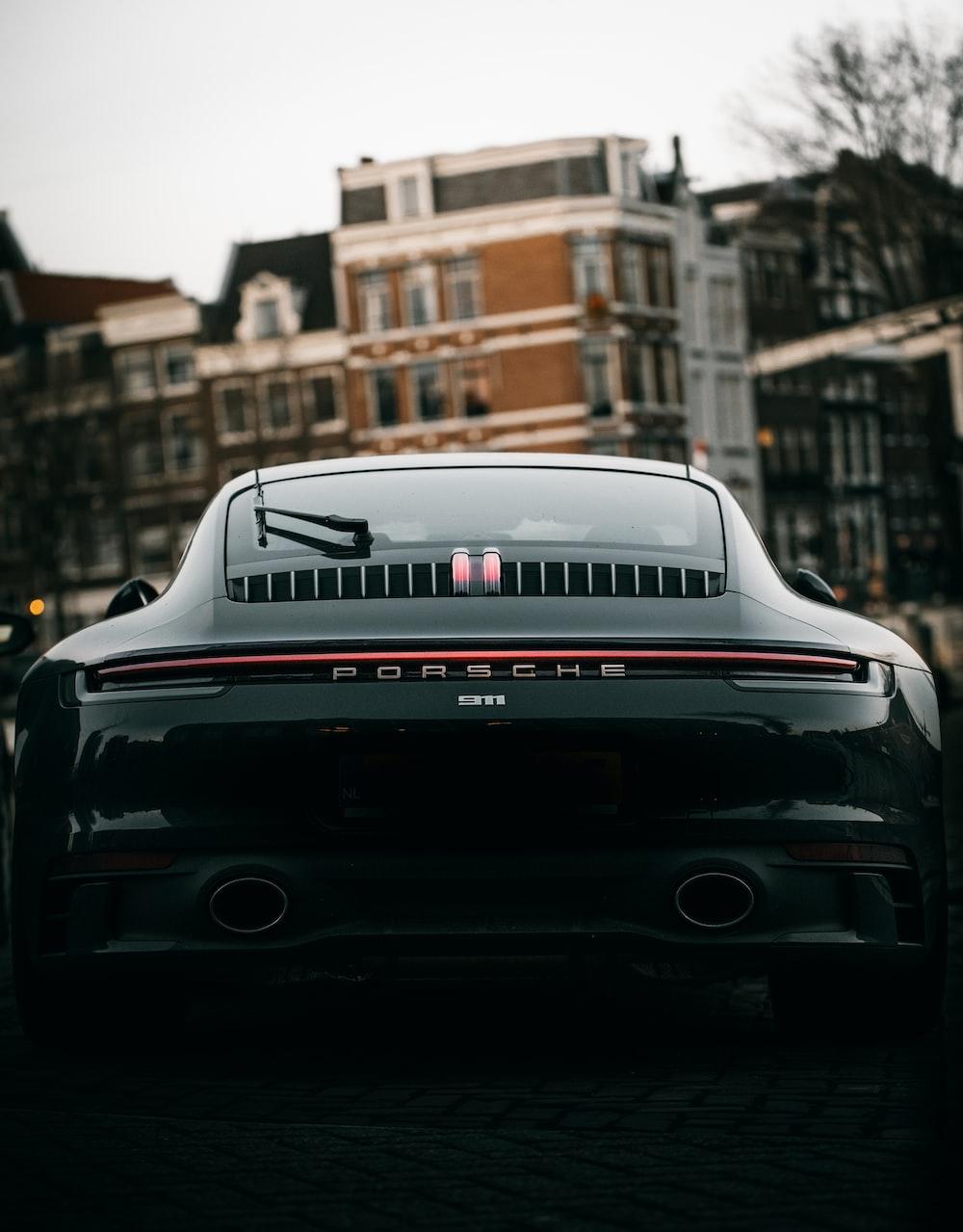 black porsche 911 parked on street during daytime