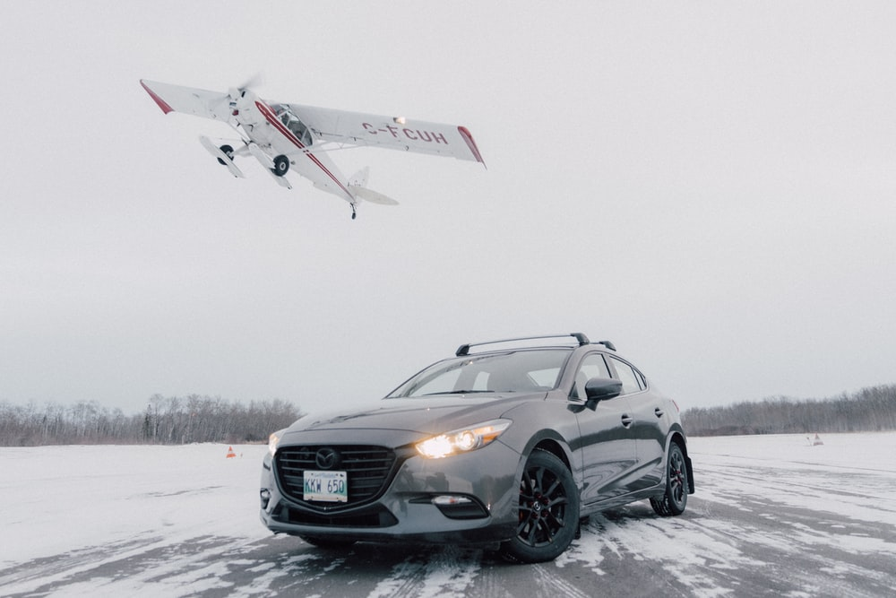black mercedes benz c class on snow covered ground during daytime