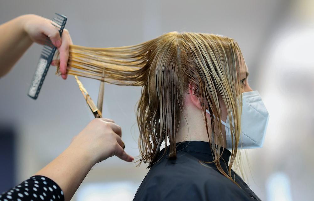 Woman getting dye and cut