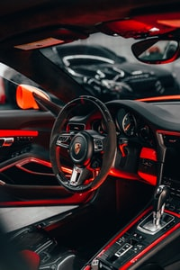 black and red bmw car steering wheel
