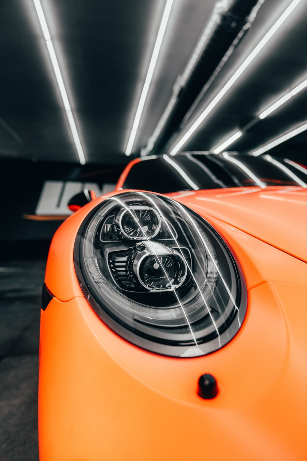 orange and black car in close up photography