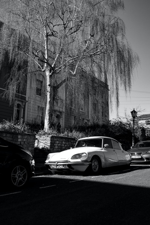 white sedan parked beside black car