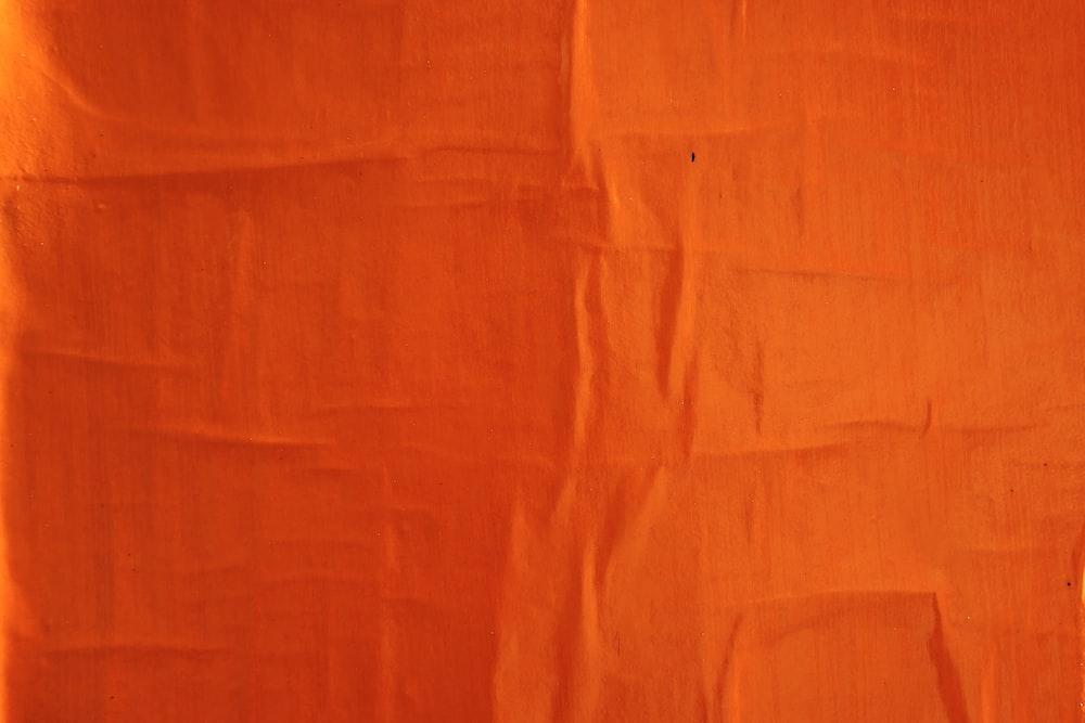 orange textile on white textile